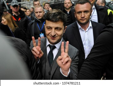 KYIV, UKRAINE- April 19, 2019:Ukrainian presidential candidate Volodymyr Zelensky greets his supporters after debate at Olympiysky Stadium with Ukraine's President Petro Poroshenko