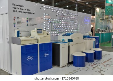 KYIV, UKRAINE - APRIL 20, 2016: Roche serum test systems at booth during VII International Medical Forum. Hoffmann-La Roche AG is a Swiss multinational healthcare company founded in 1896.