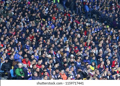 KYIV, UKRAINE - APRIL 21, 2017: Crowded tribunes of NSC Olimpiyskyi stadium in Kyiv during the Ukrainian Premier League game FC Dynamo Kyiv vs Shakhtar Donetsk