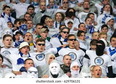 KYIV, UKRAINE - APRIL 21, 2017:FC Dynamo Kyiv ultra supporters show their support  during Ukrainian Premier League game against Shakhtar Donetsk at on Olympic stadium (NSC Olimpiysky) in Kyiv, Ukraine