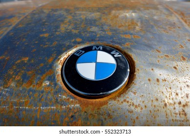 KYIV, UKRAINE  - APRIL 23, 2016: Rusted hood with the logo BMW at the festival OldCarLand-2016 in Kiev.