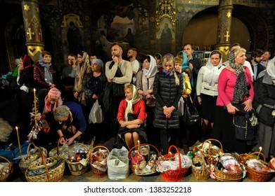 KYIV, UKRAINE- April 28, 2019: Ukrainian Orthodox believers attend an Orthodox Easter service in the Kyiv-Pechersk Lavra church