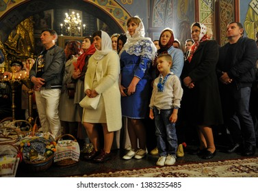 KYIV, UKRAINE- April 28, 2019: Ukrainian Orthodox believers attend an Orthodox Easter service in Mikhaylivsky Cathedral.