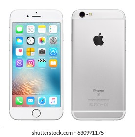 Kyiv, Ukraine - April 30, 2017: Front view of Silver Apple iPhone 6S with iOS 10.3.1 mobile operating system and back side with Apple Inc logo. Isolated on white with clipping path.