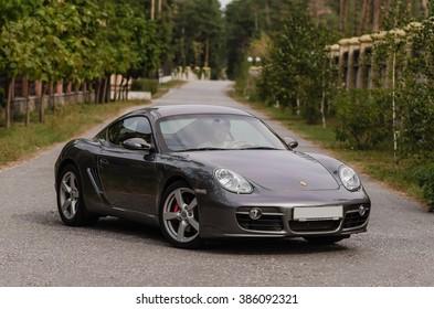 Kyiv, Ukraine - April 4th, 2014: Photoshoot of Porsche Cayman on street