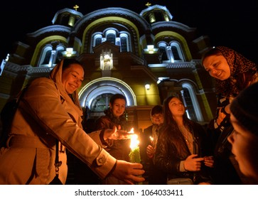 KYIV, UKRAINE- April 7, 2018: Ukrainian Orthodox faithful light candles from the Holy Fire brought from Jerusalem in St. Volodymyr Cathedral during the ceremony of the Holy Fire.