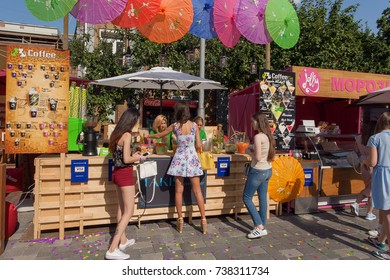 KYIV, UKRAINE - AUG 19: Many young happy people buying drinks and street food at outdoor pop-up cafe during Street Food Festival on August 19, 2017. Kiev is the 8th most populous city in Europe.