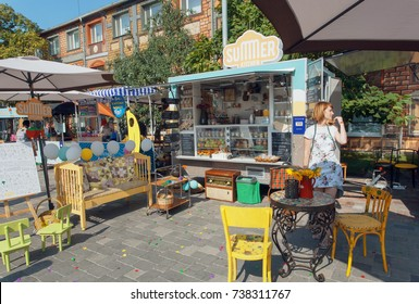 KYIV, UKRAINE - AUG 19: Seller of fast-food and fresh drinks on outdoor pop-up cafe during Street Food Festival on August 19, 2017. Kiev is the 8th most populous city in Europe.