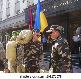 KYIV, UKRAINE - Aug 5, 2014: Nearly a hundred Cossacks, arrived in Kyiv from Zaporozhye, installed in front of the Prosecutor General's Office in Kiev symbolic barricade.
