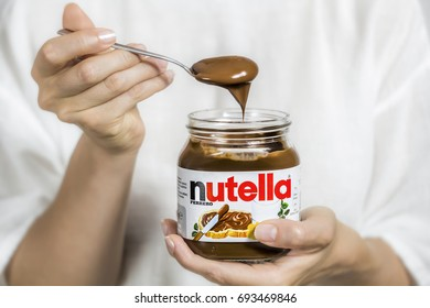 Kyiv, Ukraine - Aug 5th, 2017: Jar of Nutella. Spoon in chocolate cream, dessert.