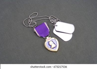 KYIV, UKRAINE - August 1, 2016. Purple Heart award on US ARMY olive green uniform