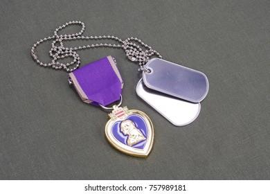 KYIV, UKRAINE - August 1, 2016. Purple Heart award on green uniform with dog tags