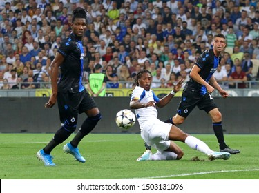 KYIV, UKRAINE - August 13, 2019: Simon Deli (L), Brandon Mechele (R) of Club Brugge and Gerson Rodrigues of Dynamo Kyiv in action during their UEFA Champions League game at Olympic stadium in Kyiv