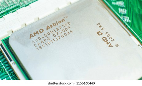 KYIV, UKRAINE - AUGUST 14, 2018: AMD Athlon processor chip on mainboard. American multinational semiconductor company AMD is the largest manufacturer of central and graphics processors