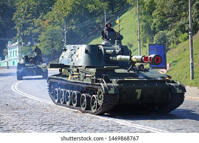 """Kyiv, Ukraine - August 24, 2018: Self-propelled howitzer """"Akatsia"""" is driving over the city streets. Military technique parade in Kiev. Independence day celebration. Military equipment"""