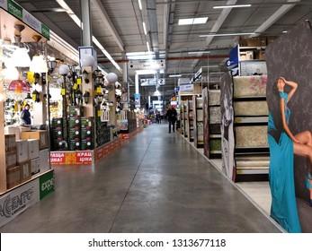 Kyiv, Ukraine - August 25, 2018: Interior of big supermarket with high shelves.