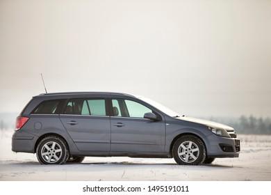 Kyiv, Ukraine - August 25, 2018: Car parked in snowy field on winter day.