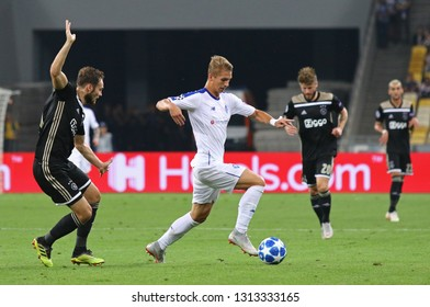 KYIV, UKRAINE - AUGUST 28, 2018: Vladyslav Supriaha of FC Dynamo Kyiv (in White) controls a ball during the UEFA Champions League play-off game against AFC Ajax at NSC Olimpiyskyi stadium in Kyiv