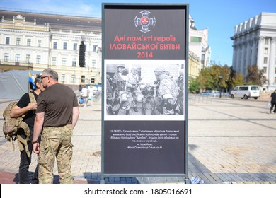 KYIV, UKRAINE - AUGUST 29, 2020: People at a memorial wall for soldiers killed in the recent conflict in Eastern Ukraine  of the Battle of Ilovaisk