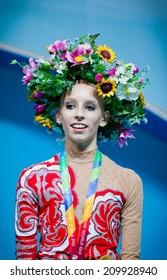 KYIV, UKRAINE - AUGUST 30, 2013: Yana Kudryavtseva (Russia) - gold medallists of 32nd Rhythmic Gymnastics World Championship (Individual All-Around competition) stand at podium