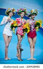 KYIV, UKRAINE - AUGUST 30, 2013: Ganna Rizatdinova (L), Yana Kudryavtseva (C) and Melitina Staniouta - medallists of 32nd Rhythmic Gymnastics World Championship (Individual All-�Around competition)
