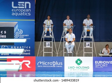KYIV, UKRAINE - AUGUST 9, 2019: Diving referees in action during the Mixed 10m Synchro Final of the 2019 European Diving Championship in Kyiv, Ukraine