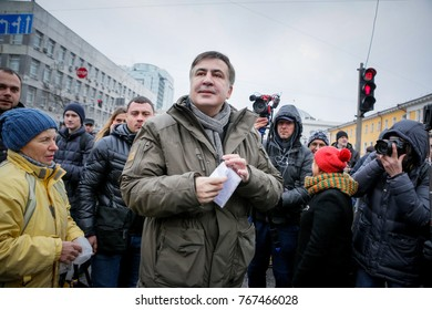 Kyiv, Ukraine - Dec 03, 2017: Former Georgian president and ex-Odessa Governor Mikheil Saakashvili (C) walks together with supporters during their rally in downtown Kiev