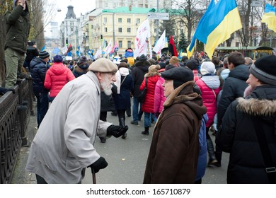 KYIV, UKRAINE - DEC 1: Two seniors talking about politics on anti-government demonstration during the pro-European protest on December 1, 2013 in the center of Kiev, Ukraine