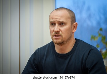 """KYIV, UKRAINE - DEC 24, 2016: Chief of Ukrainian National Patrol Police Evgeny Zhukov gives interview in his office. Cyborg """"Marshal"""" was awarded the national order of """"National Hero of Ukraine""""."""