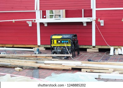 KYIV, UKRAINE - December, 04, 2018:  Backup Portable Generator on Construction Site. Mobile Backup Generator on house construction site.