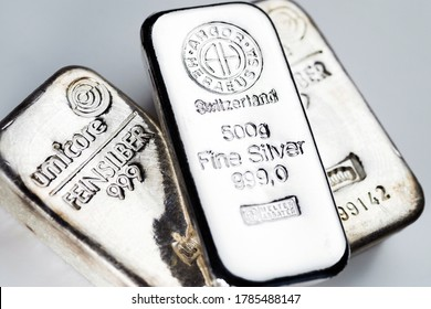 Kyiv, Ukraine - December 05, 2018: several silver bars of famous world manufacturers on a light background.
