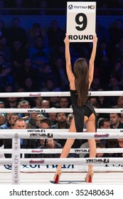 KYIV, UKRAINE - DECEMBER 12, 2015: Boxing ring girls holding a board with round number during WBO Intercontinental cruiserweight Title fight Oleksandr Usyk vs Pedro Rodriguez at Palace of Sports