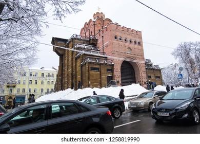 Kyiv, Ukraine - December 15, 2018: Winter in the city, snow covered trees. Golden gate in Kyiv, Ukraine.