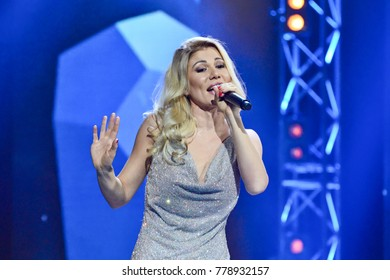 "KYIV, UKRAINE - DECEMBER 19, 2017: Ukrainian singer Tamerlan and Alena on stage during concert ""Music platform of Ukraine"" in Kiev"