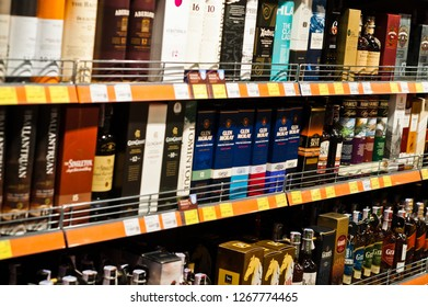 Kyiv, Ukraine - December 19, 2018: Bottles of different elite alcohol on shelves in a supermarket.