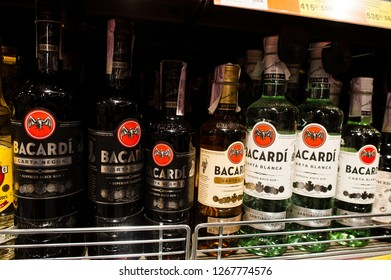 Kyiv, Ukraine - December 19, 2018: Bottles of Bacardi on shelves in a supermarket. Bacardi Limited is the largest privately held, family-owned spirits company in the world.