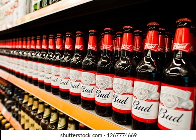 Kyiv, Ukraine - December 19, 2018: Bud beer bottles on shelves in a supermarket. Budweiser  is an American-style pale lager produced by Anheuser-Busch.