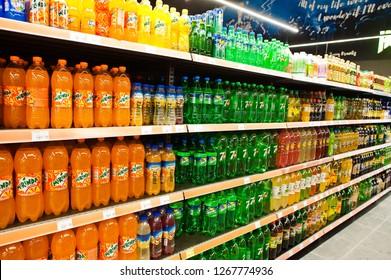 Kyiv, Ukraine - December 19, 2018: Plastic bottles of soda drinks Mirinda, Sprite, 7up and others on supermarket stand shelves.
