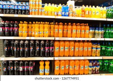 Kyiv, Ukraine - December 19, 2018: Plastic bottles of soda drinks Pepsi, Fanta, Mirinda and Sprite on supermarket stand shelves.