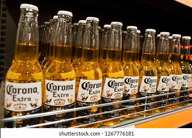 Kyiv, Ukraine - December 19, 2018: Corona extra beer bottles on shelves in a supermarket. Corona Extra is a pale lager produced by Cervecería Modelo in Mexico