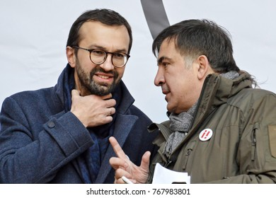 KYIV, UKRAINE - DECEMBER 3, 2017: Former Georgian president and former governor of the Odessa region Mikheil Saakashvili (R) and Serhiy Leshchenko (L) at the Impeachment March in Kiev