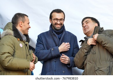 KYIV, UKRAINE - DECEMBER 3, 2017: Former Georgian president and former governor of the Odessa region Mikheil Saakashvili (R), Serhiy Leshchenko (C) and Derevyanko Yuiy (L) at the Impeachment March
