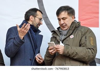 KYIV, UKRAINE - DECEMBER 3, 2017: Former Georgian president and former governor of the Odessa region Mikheil Saakashvili (R), Serhiy Leshchenko (L) at the Impeachment March in Kiev
