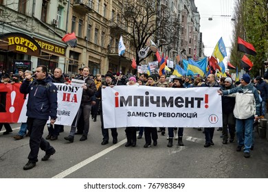 KYIV, UKRAINE - DECEMBER 3, 2017: Supporters of the Movement of New Forces, the political party led by Mikheil Saakashvili, march, calling for Ukraine's President Poroshenko to resign in central Kiev