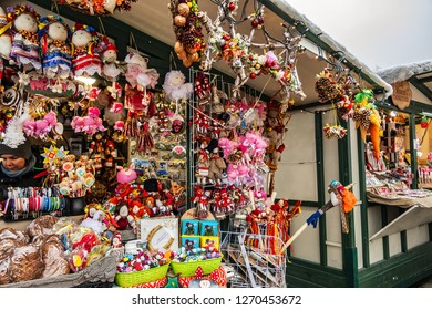 KYIV, UKRAINE - DECEMBER 30, 2018: Kyiv celebrates New Year: Gift shops on Sophia Square with different New Year decoration elements, toys, souvenirs and sweets.