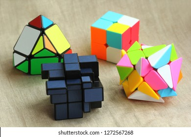 Kyiv, Ukraine - December 30, 2018: Closeup of various pyramid and cube toy puzzles