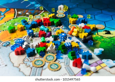 Kyiv, Ukraine - December 4 2017: Board game concept- many board game field figures, meeple, dice and coins