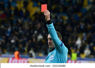 KYIV, UKRAINE - DECEMBER 6, 2016: The referee shows a red card during the UEFA Champions League football match between FC Dynamo Kyiv and Besiktas at the Olympiyski Stadium