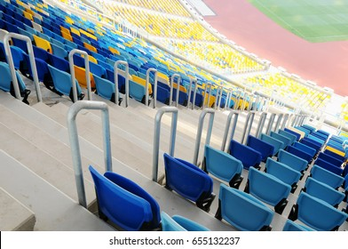 KYIV, UKRAINE - DECEMBER 6, 2016: Beautiful panoramic views of the NSC Olympic Stadium without spectators before the match. Seats for spectators of blue-yellow color close-up