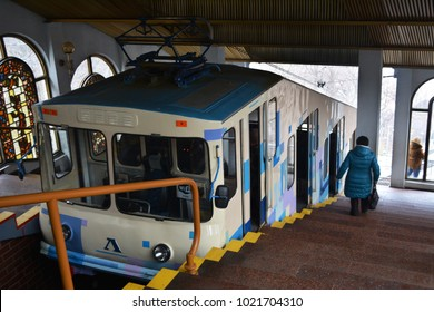 Kyiv, Ukraine - February 03,2018:  Ancient Kiev funicular railway 1905. Interior of the stations with a cable car  and colorful stained-glass windows. Boarding and disembarking of passengers.